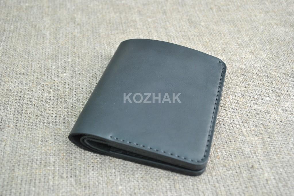 Черный портмоне двойного сложения из натуральной кожи
