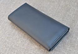 Черный кожаный вместительный кошелек