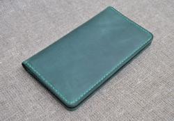 Портмоне зеленого цвета из натуральной кожи