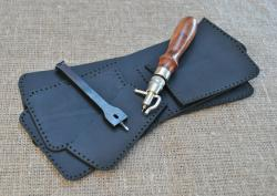 Маленький кошелек черного цвета из натуральной кожи